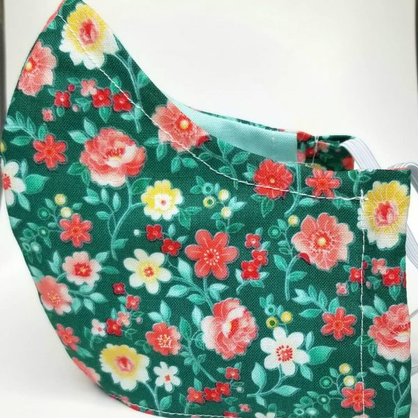 Green, peach flowers mask